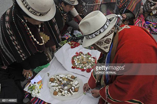 Amautas perform a ritual to thank the Pachamama for the arrival of the 2017 Dakar Rally in La Paz on January 7 2017 / AFP / JORGE BERNAL