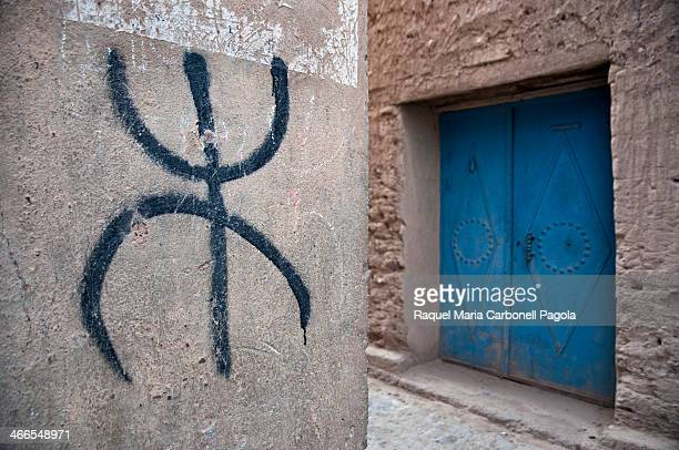 Amazigh/Berber symbol painted on a wall in a traditional adobe Ksar