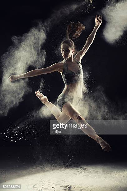 Amazing ballet dancer dancing in powder snow