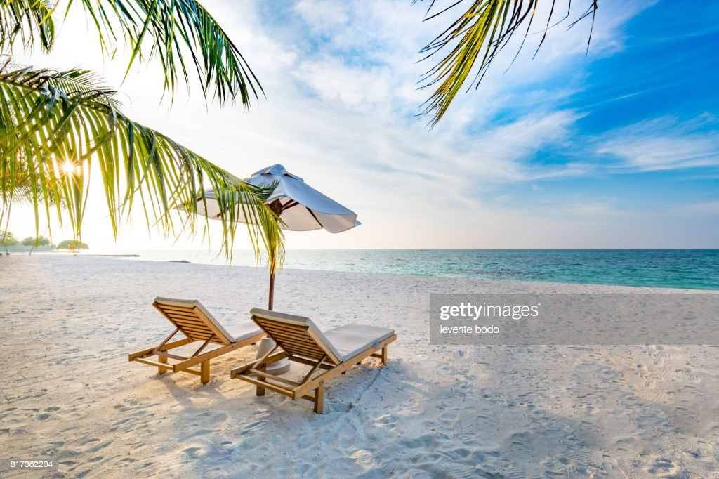 Amazing beach sunset. Beach scene with relaxing mood. : Stock Photo