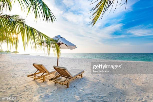 amazing beach sunset. beach scene with relaxing mood. - outdoor chair stock pictures, royalty-free photos & images