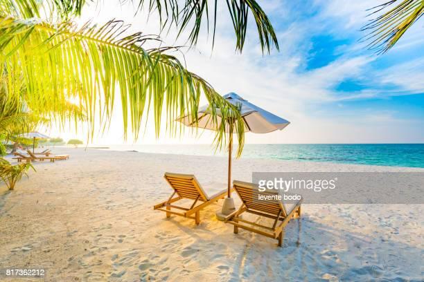 Amazing beach sunset. Beach scene with relaxing mood.