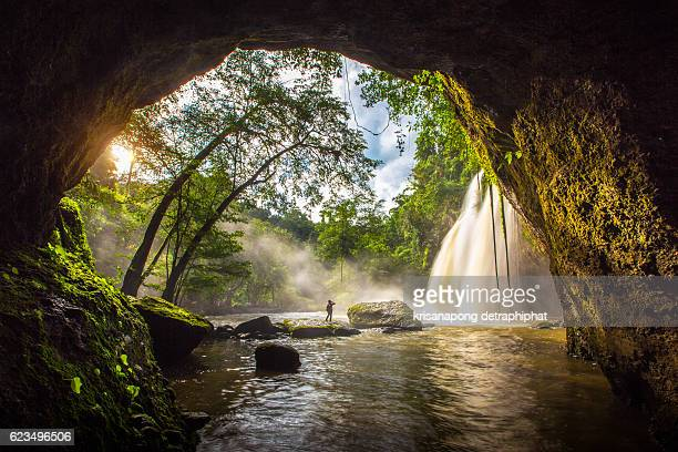 amazing beautiful waterfalls in deep forest at haew suwat waterfall in khao yai national park, thailand - cave stock pictures, royalty-free photos & images