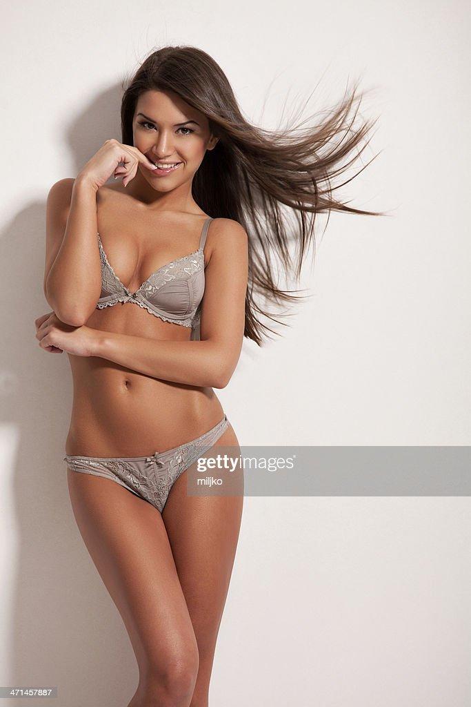 Amazing brunette posing in lingerie : Stock Photo