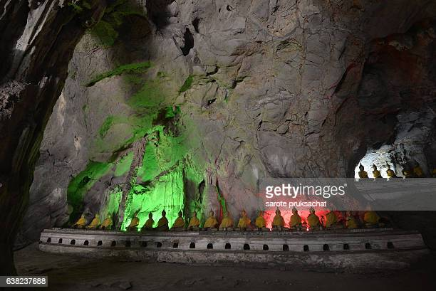 Amazing Buddhism with the ray of light in the cave . Khao Luang Cave, Phetchaburi, Thailand.