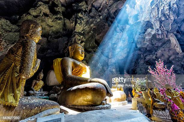 amazing buddhism with the ray of light in the cave - sri lanka stock pictures, royalty-free photos & images