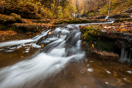 Amazing Cascades du Hérisson during autumn with forest and waterfalls. - gettyimageskorea