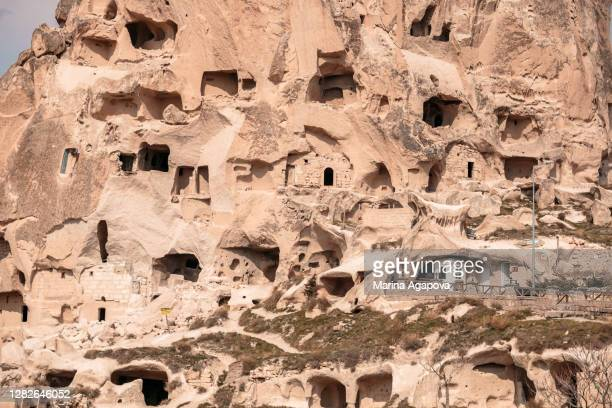 amazing cave houses in cappadocia - cliff dwelling stock pictures, royalty-free photos & images