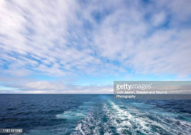 amazing cloudscape over blue waters of iceland in summer - passenger craft stock pictures, royalty-free photos & images