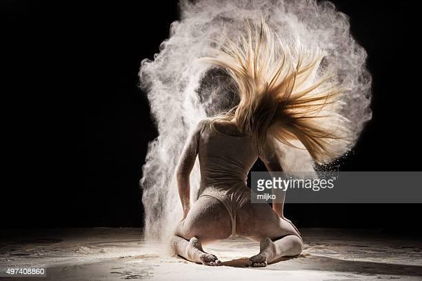 Amazing dancer dancing in powder snow