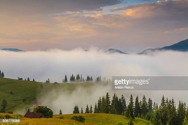 amazing dawn sky over the misty mountains - anton petrus stock pictures, royalty-free photos & images