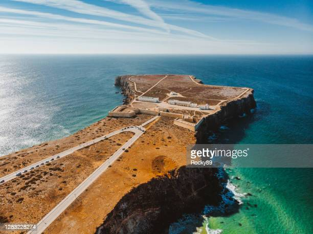 amazing drone shot of sagres fortress and church of our lady of grace, portugal - sagres stock pictures, royalty-free photos & images