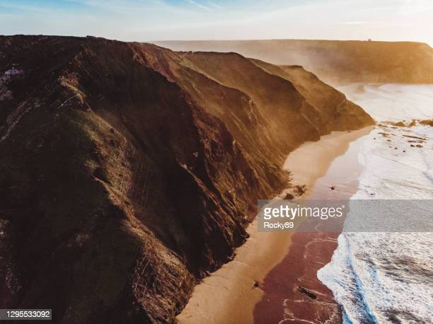 amazing drone shot the beautiful algarve coastline at praia do castelejo and praia da cordoama, portugal - drone point of view stock pictures, royalty-free photos & images