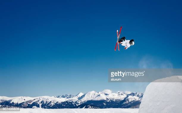 amazing freestyle skiing jumps in the pyrenees mountains - boarding stock pictures, royalty-free photos & images