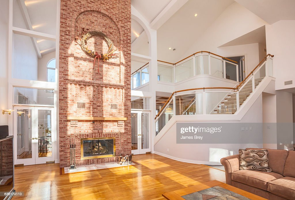 Amazing Home Interior With Brick Fireplace And Spectacular Glass Staircase High Res Stock Photo Getty Images