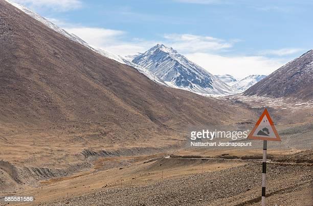 Amazing horizontal view of Himalaya mountain range with road sign
