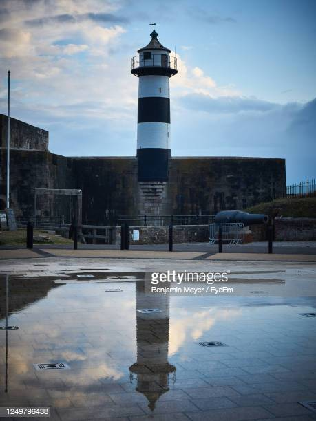 amazing lighthouse captured featuring a reflection of the building. - portsmouth england stock pictures, royalty-free photos & images