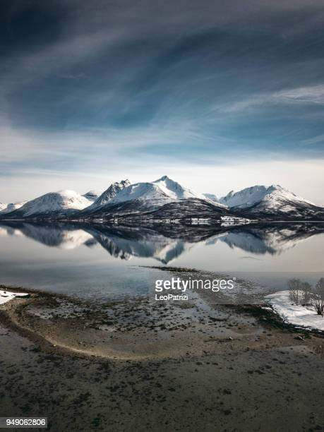 amazing mountain reflections on the fjord - balsfjord in norway - coastline stock pictures, royalty-free photos & images