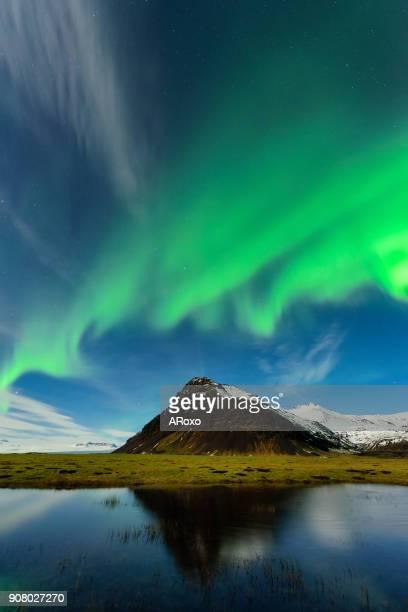 Amazing nightscape with Aurora Borealis over Iceland