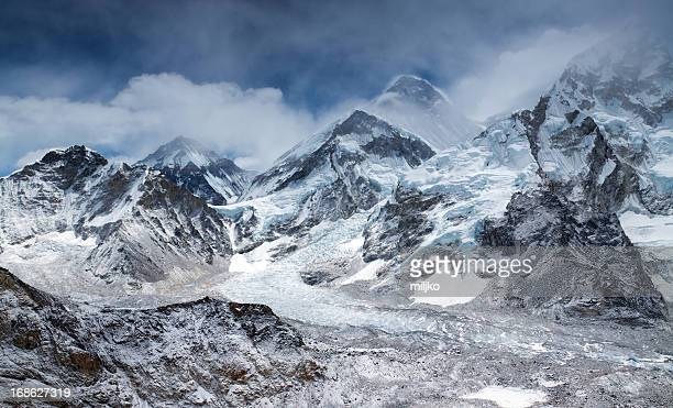 amazing panorama of himalayas mountain range on partly cloudy day - khumbu stock pictures, royalty-free photos & images