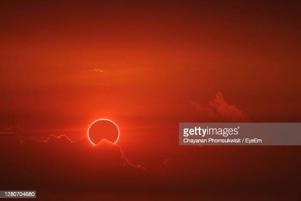 amazing phenomenon of total sun eclipse over cloud sunset red orange sky on the sea and ocean - light natural phenomenon stock pictures, royalty-free photos & images