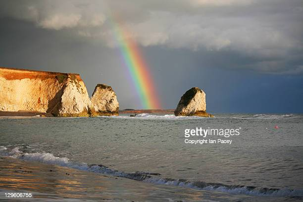amazing rainbow at freshwater bay - freshwater bay isle of wight ストックフォトと画像