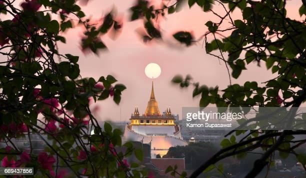 Amazing scene of sun straight on the top of golden pagoda mountain in Bangkok,Thailand dream destination for tourist
