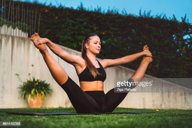 amazing skills of a young gymnast - chubby legs stock photos and pictures