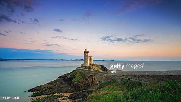Amazing sunrise at lighthouse Phare du Petit Minou in the Finistere, Brittany, France
