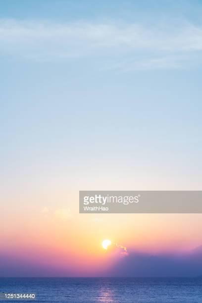 amazing sunset near the sea in okinawa - 夜明け ストックフォトと画像