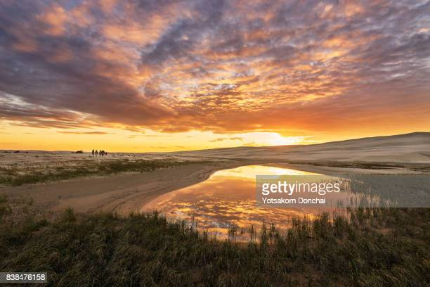 Amazing sunset over Stockton Sand Dunes with reflection at a pond, Newcastle