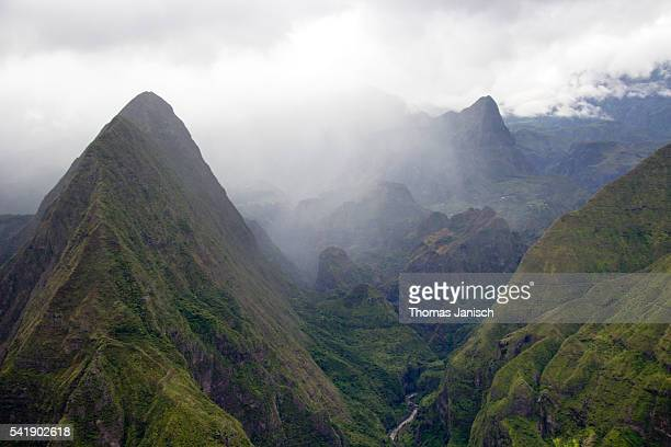 Amazing view from Cap Noir into cloud-covered Cirque de Mafate, Reunion island