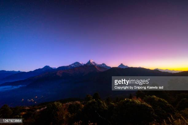amazing view of the annapurna mountain range from poon hill viewpoint at dawn, nepal. - annapurna south stock pictures, royalty-free photos & images