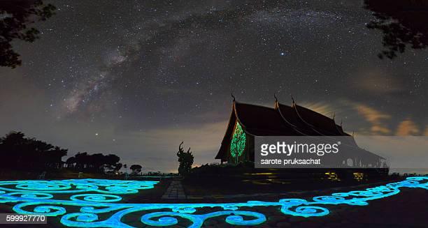 Amazing Wat Sirindhorn,stars  and milky way night sky temple in Northeast  Thailand .