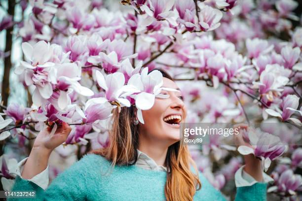 amazing young woman posing in apricot tree orchard at spring - apricot tree stock pictures, royalty-free photos & images
