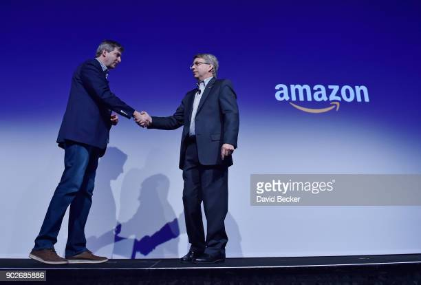 Amazon Alexa Senior Vice President Tom Taylor and Panasonic Corporation of North America President and CEO Tom Gebhardt shake hands during a...