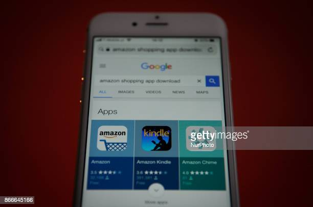 Amazon applications for download are seen on a Google search page on an iPhone on October 25 2017