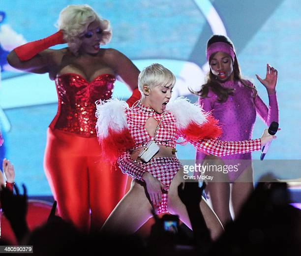 Amazon Ashley and Miley Cyrus perform at Philips Arena on March 25 2014 in Atlanta Georgia