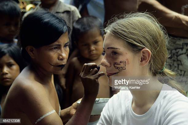 Amazon Bora Indians Girl Tourist Having Face Painted With Traditional Plant Dyes