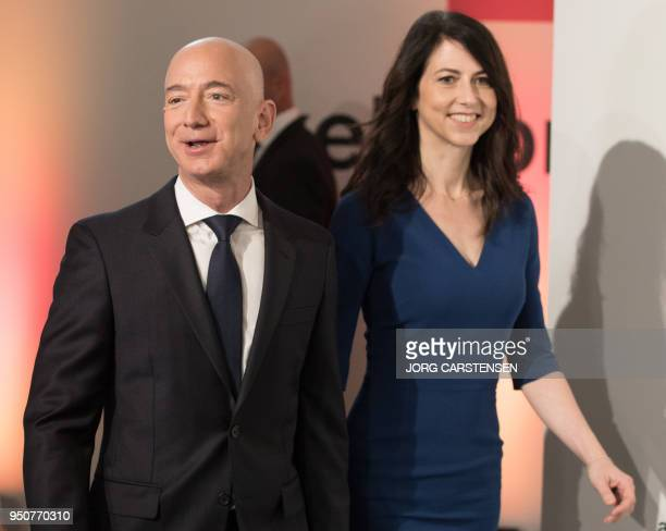 Amazon CEO Jeff Bezos and his wife MacKenzie Bezos arrive at the headquarters of publisher AxelSpringer where he will receive the Axel Springer Award...