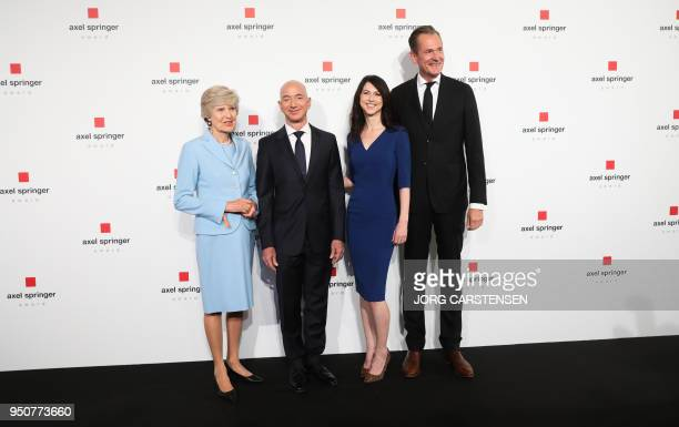 Amazon CEO Jeff Bezos and his wife MacKenzie Bezos pose with publisher Springer CEO Mathias Doepfner publisher Friede Springer as they arrive at the...