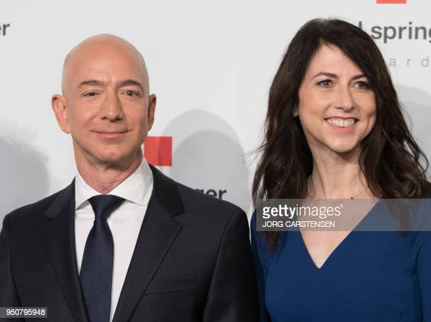 Amazon CEO Jeff Bezos and his wife MacKenzie Bezos poses as they arrive at the headquarters of publisher Axel-Springer where he will receive the Axel...