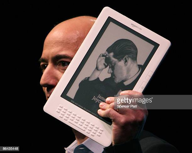 Amazon CEO Jeff Bezos holds the new Kindle DX which he unveiled at a press conference at the Michael Schimmel Center for the Arts at Pace University...