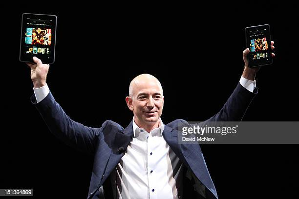 Amazon CEO Jeff Bezos holds up the new Kindle Fire HD reading device in two sizes during a press conference on September 6 2012 in Santa Monica...