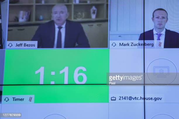 Amazon CEO Jeff Bezos left and Facebook CEO Mark Zuckerberg look on via video conference during the House Judiciary Subcommittee on Antitrust...