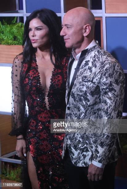 Amazon CEO Jeff Bezos right along with American news anchor Lauren Sanchez poses for photographs during a blue carpet event organized by Amazon Prime...