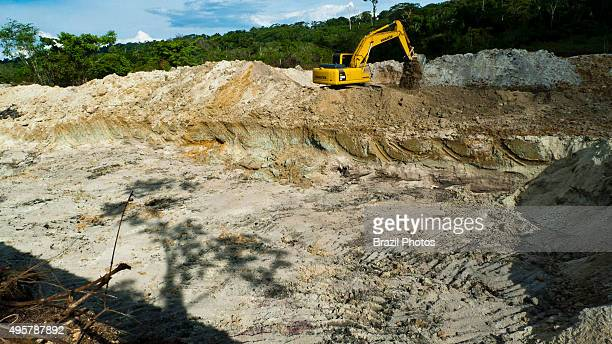Amazon deforestation remaining tree starting of hydraulic gold mining operation process known as 'chupadeira system' use of heavy machinery for...