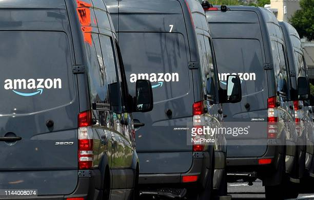 Amazon delivery vans are seen on May 14, 2019 in Orlando, Florida. On May 13, 2019 Amazon announced an incentive program that offers three months pay...