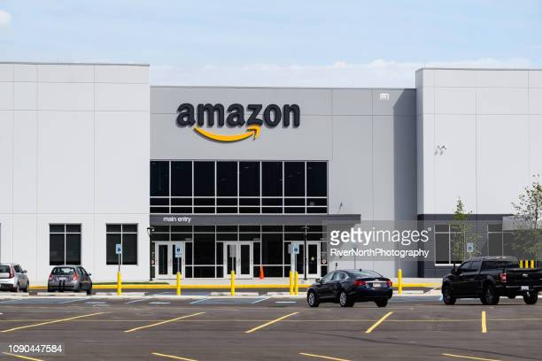 amazon distribution center, shelby twp, michigan - amazon warehouse stock pictures, royalty-free photos & images