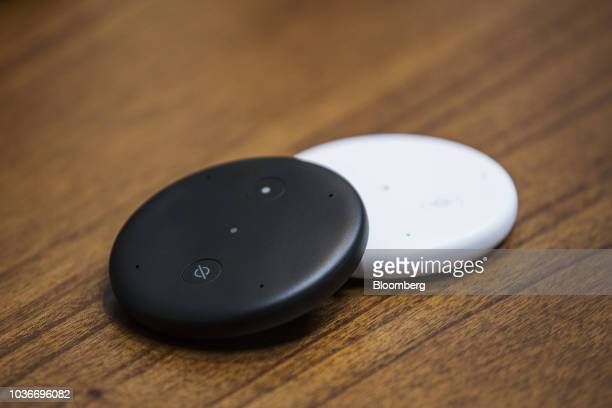 Amazon Echo Input devices sit on display at the Amazoncom Inc Spheres headquarters during an unveiling event in Seattle Washington US on Thursday...